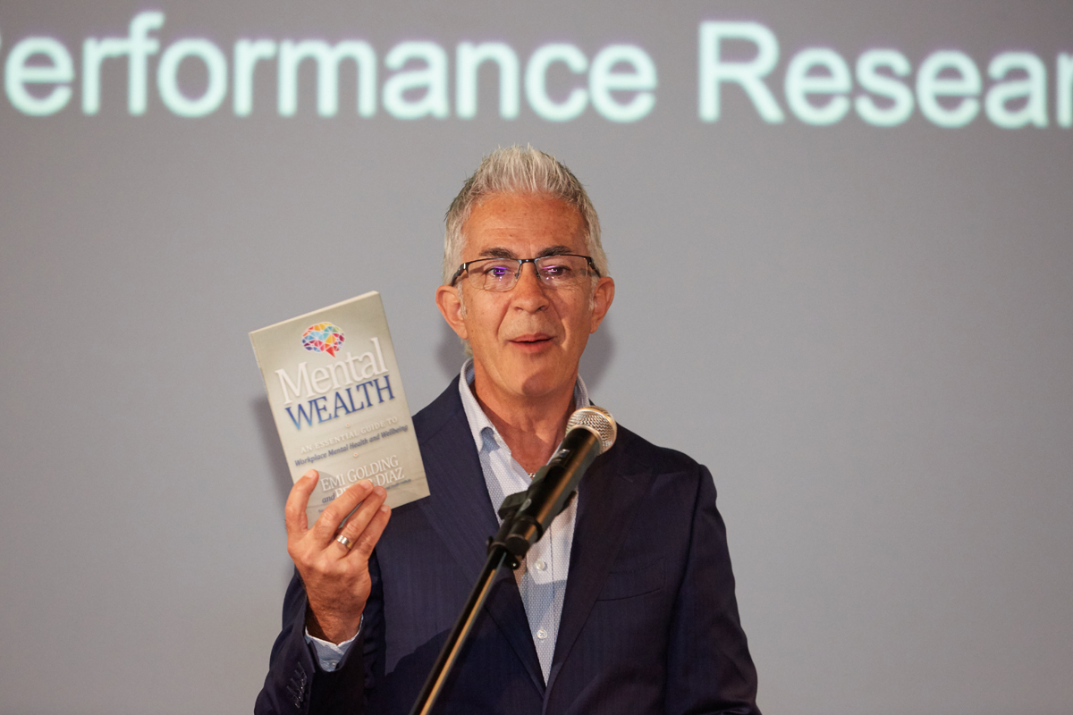 Craig Carr with Mental Wealth book