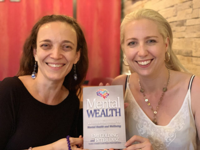 Begoña Gomez and Emi Golding with Mental Wealth book