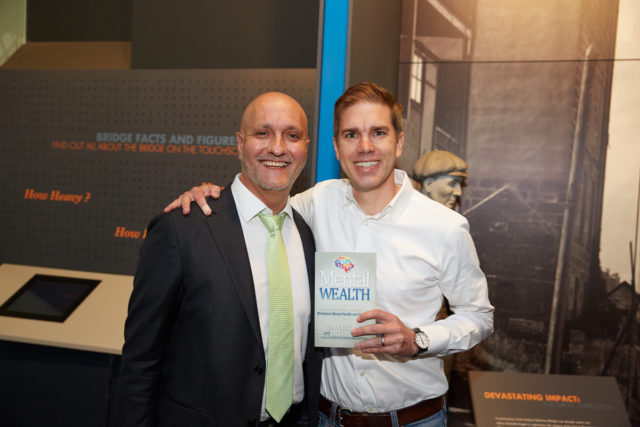 Chris Zumwalt (BridgeClimb Sydney CEO) with Peter and the Mental Wealth book