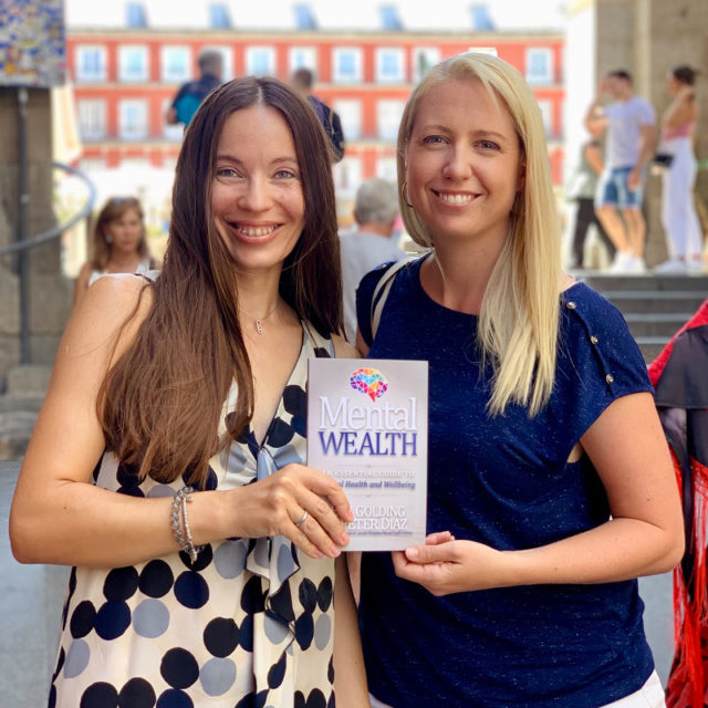 Emi Golding and Natalia Luneva with Mental Wealth book
