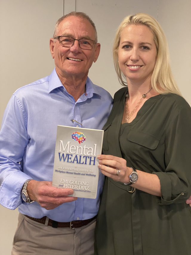 Jim Odlum with the Mental Wealth book