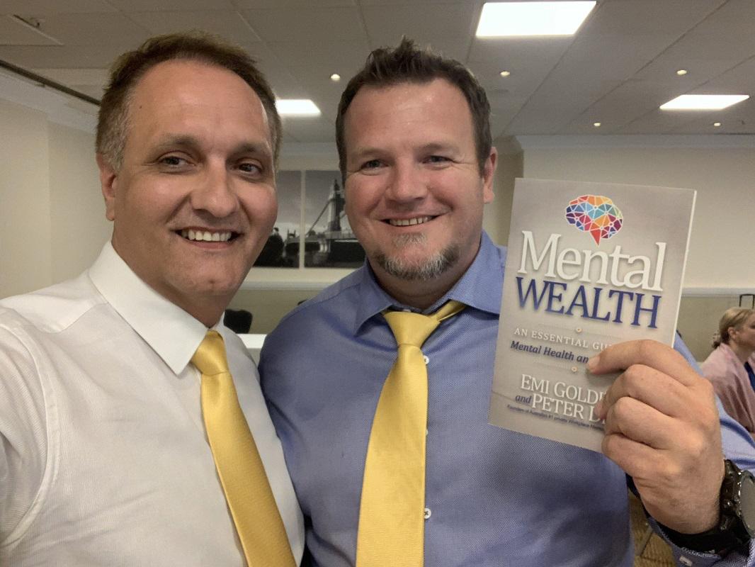Peter Diaz and Johan Van Niekerk with Mental Wealth Book
