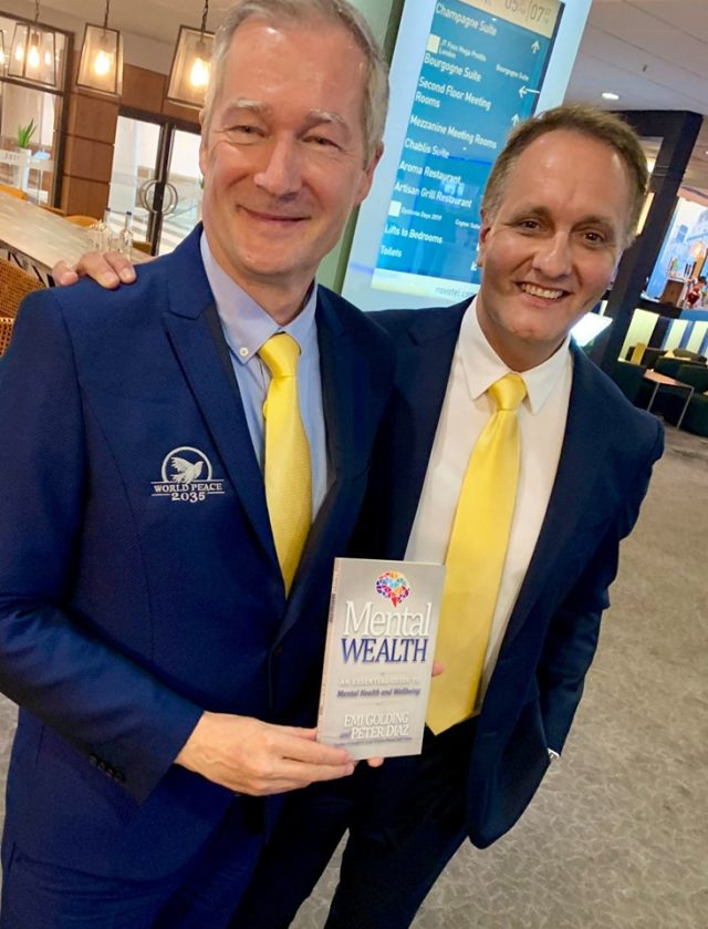 Peter Diaz with Gert Olefs with the Mental Wealth book
