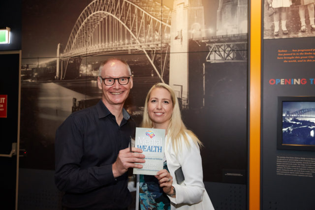 Jonathan Gliksten (Director, IGLU) with Emi Golding and the Mental Wealth book